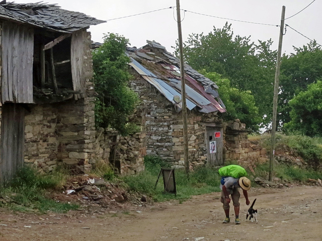 Greeting a cat in an abandoned village